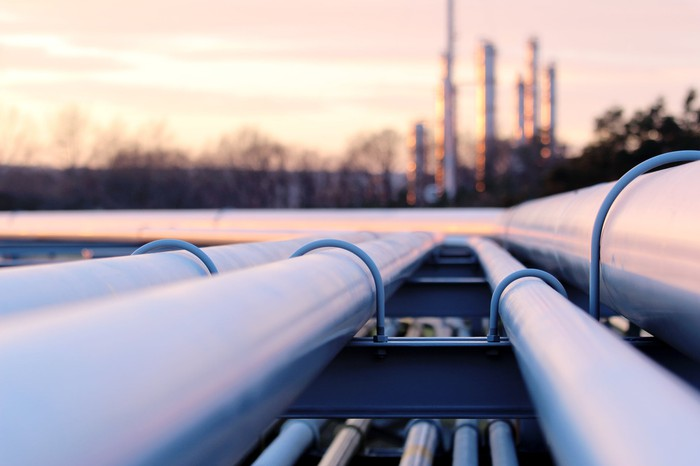 Long pipes in the crude oil plant during sunset